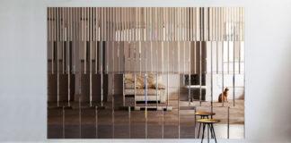 Оформление стены зеркальной фацетированной плиткой